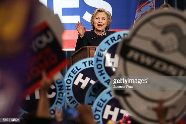 Democratic presidential candidate Hillary Clinton speaks at a rally with New York Governor Andrew Cuomo after he signed a law that will gradually...