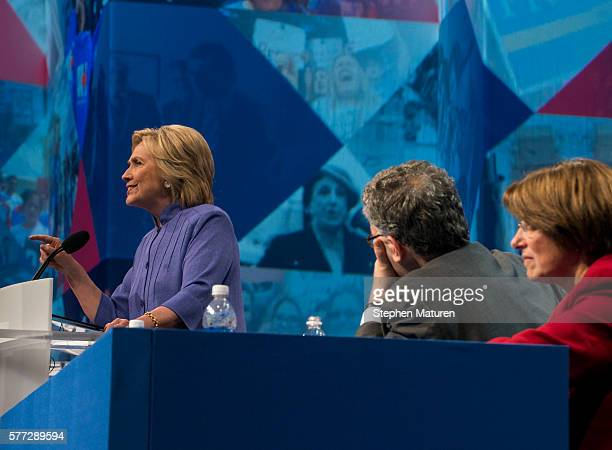 Democratic Presidential candidate Hillary Clinton speaks at the Minneapolis Convention Center as Sen Al Franken and Sen Amy Klobuchar listen on July...
