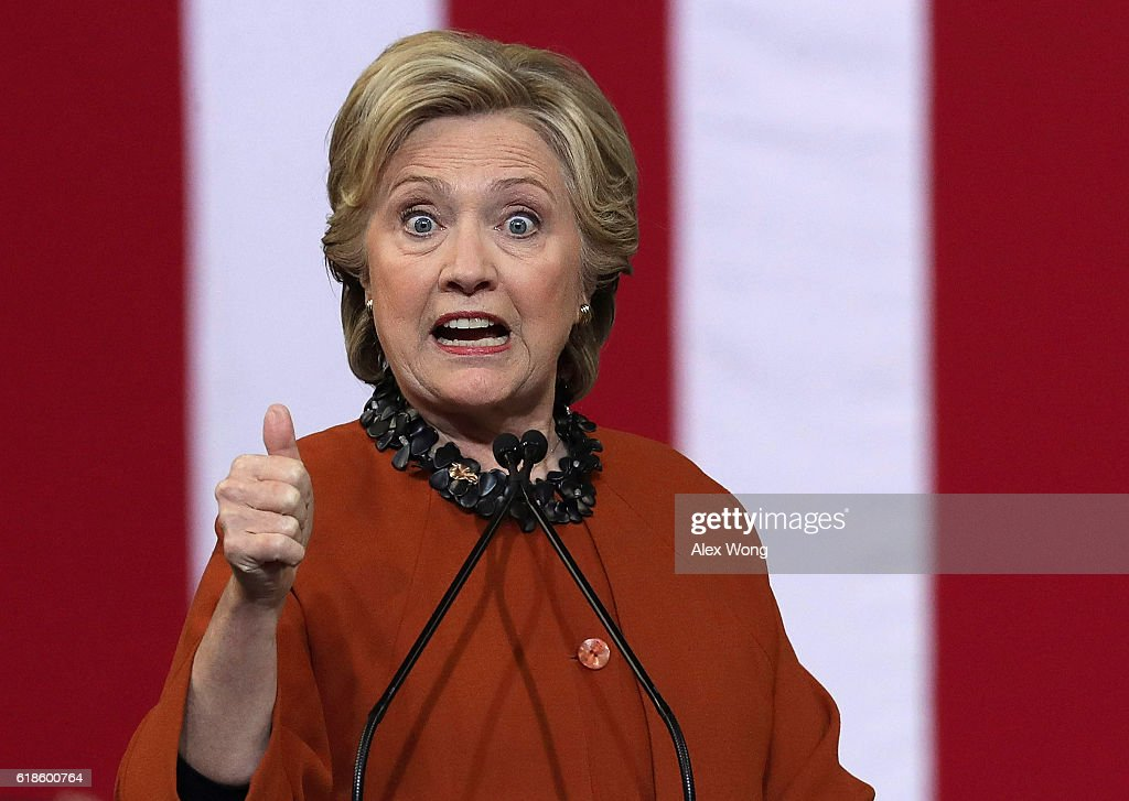 Democratic presidential candidate Hillary Clinton speaks during a campaign event at the Lawrence Joel Veterans Memorial Coliseum October 27, 2016 in Winston-Salem, North Carolina. U.S. first lady Michelle Obama joined Clinton for the first time to campaign for the presidential election.