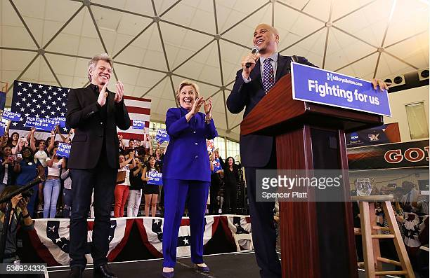 Democratic presidential candidate Hillary Clinton speaks on stage with singer Jon Bon Jovi and US Senator Cory Booker at a rally on June 1 2016 in...