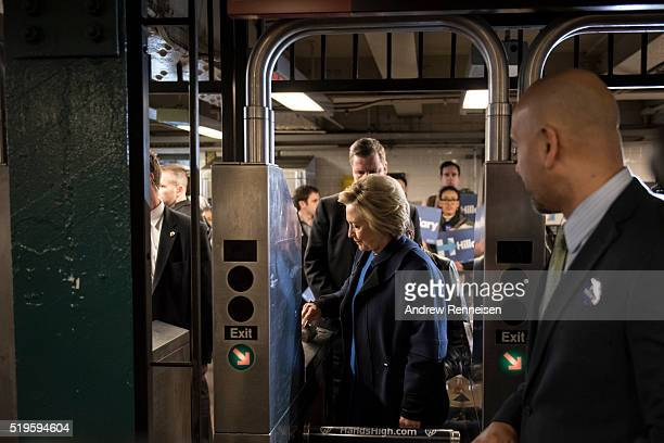 Democratic presidential candidate Hillary Clinton swipes a MetroCard to ride the No 4 train as she campaigns on April 7 2016 in the Bronx borough of...