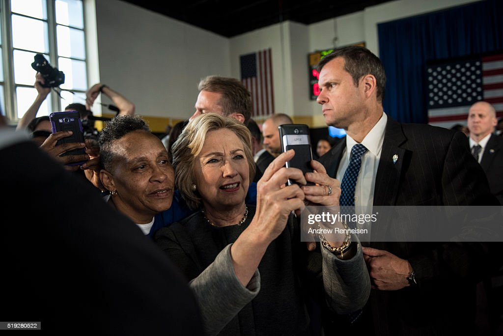 Democratic presidential candidate Hillary Clinton takes a photo with a supporter following a Women for Hillary Town Hall meeting with New York City first lady Chirlane McCray and New York Congresswomen Yvette Clarke on April 5, 2016 at Medgars Evers College in the Brooklyn borough of New York City. The meeting comes before the New York primary which takes place on April 19.