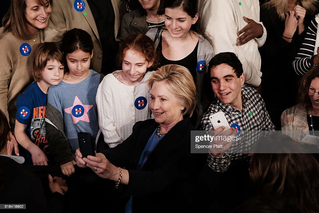 Democratic presidential candidate Hillary Clinton takes a selfie with supporters after speaking at SUNY Purchase on March 31, 2016 in Purchase, New York. Clinton gave a speech to both students and supporters that covered a host of domestic and international issues. New York will hold its primaries on April 19.