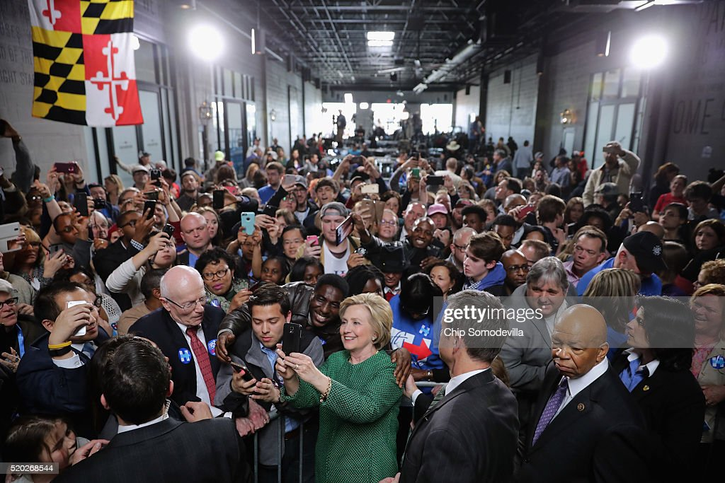 Democratic presidential candidate Hillary Clinton takes a selfie with a supporter during a campaign rally at City Garage April 10, 2016 in Baltimore, Maryland. Voters will head to polling places for Maryland's presidential primary April 26.
