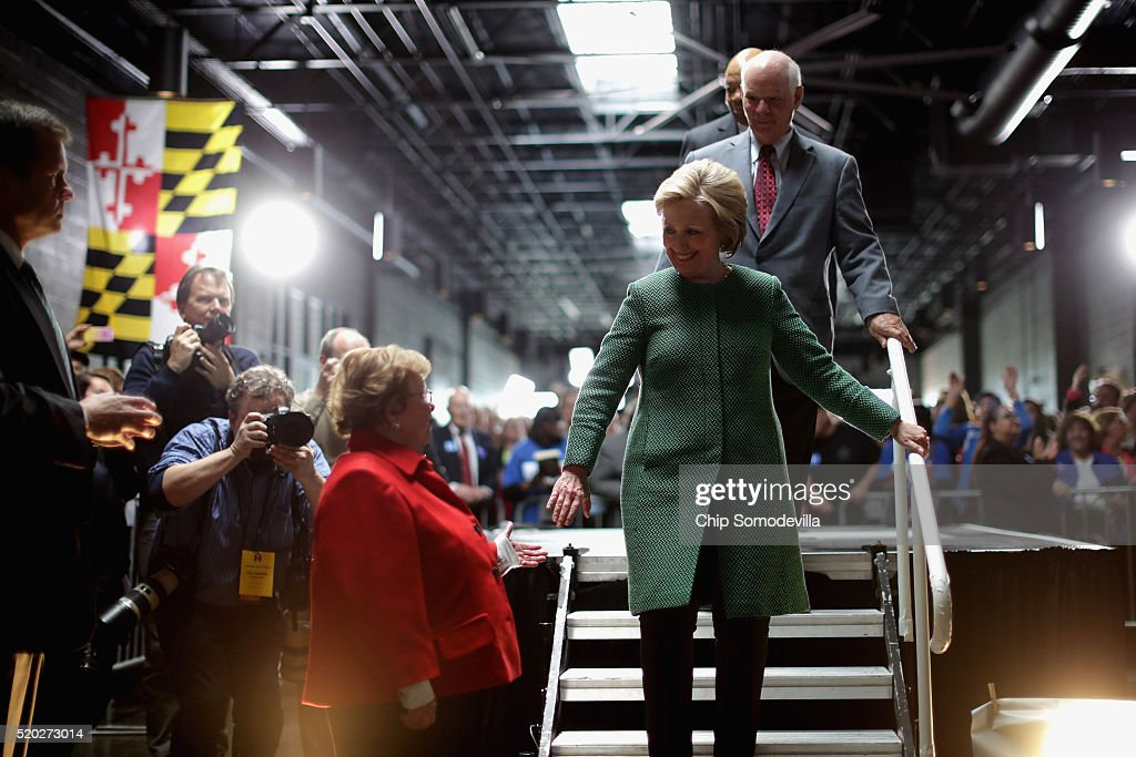 Democratic presidential candidate Hillary Clinton (C) takes the hand of Sen. Barbara Mikulski (D_MD) as she leaves the stage at the conclusion of a campaign rally at City Garage April 10, 2016 in Baltimore, Maryland. Voters will head to polling places for Maryland's presidential primary April 26.
