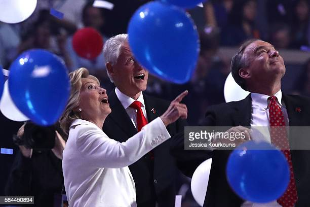 Democratic presidential candidate Hillary Clinton US Vice President nominee Tim Kaine and former US President Bill Clinton watch balloons drop at the...