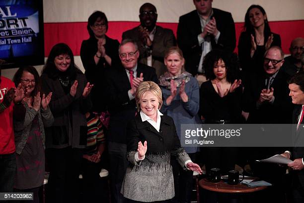 Democratic presidential candidate Hillary Clinton walks out on stage to participate in a Fox News Democratic Town Hall March 7 2016 in Detroit...