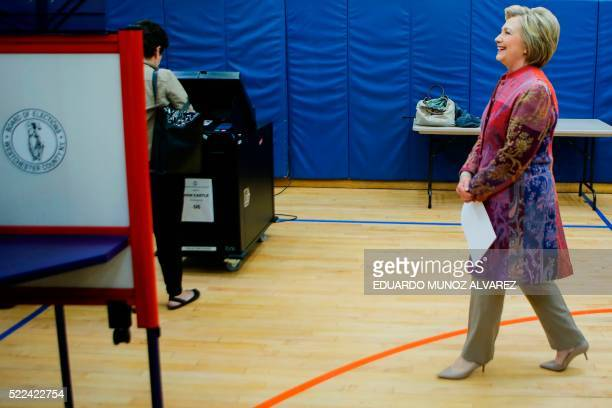 Democratic presidential candidate Hillary Clinton walks to a booth to cast her ballot at a polling station during the New York State presidential...