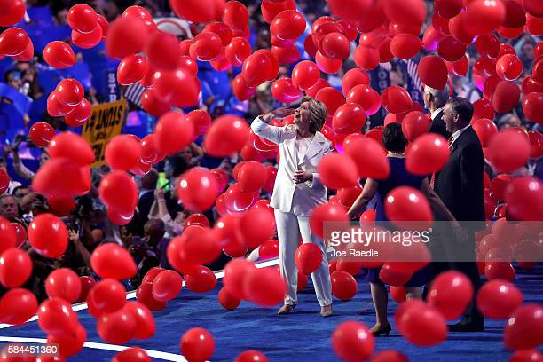Democratic presidential candidate Hillary Clinton watches balloons drop at the end of the fourth day of the Democratic National Convention at the...