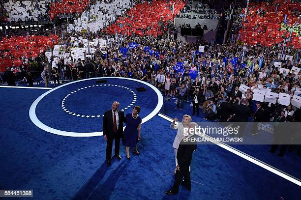 Democratic Presidential candidate Hillary Clinton watches pyrotechnics with her husband former US President Bill Clinton running mate Democratic Vice...