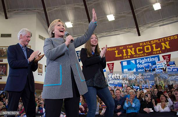 Democratic presidential candidate Hillary Clinton waves to supporters after being introduced by her husband former US president Bill Clinton and...