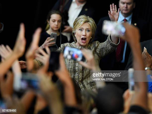 Democratic presidential candidate Hillary Clinton waves to the crowd during a campaign rally at the Southwest College in Los Angeles California on...