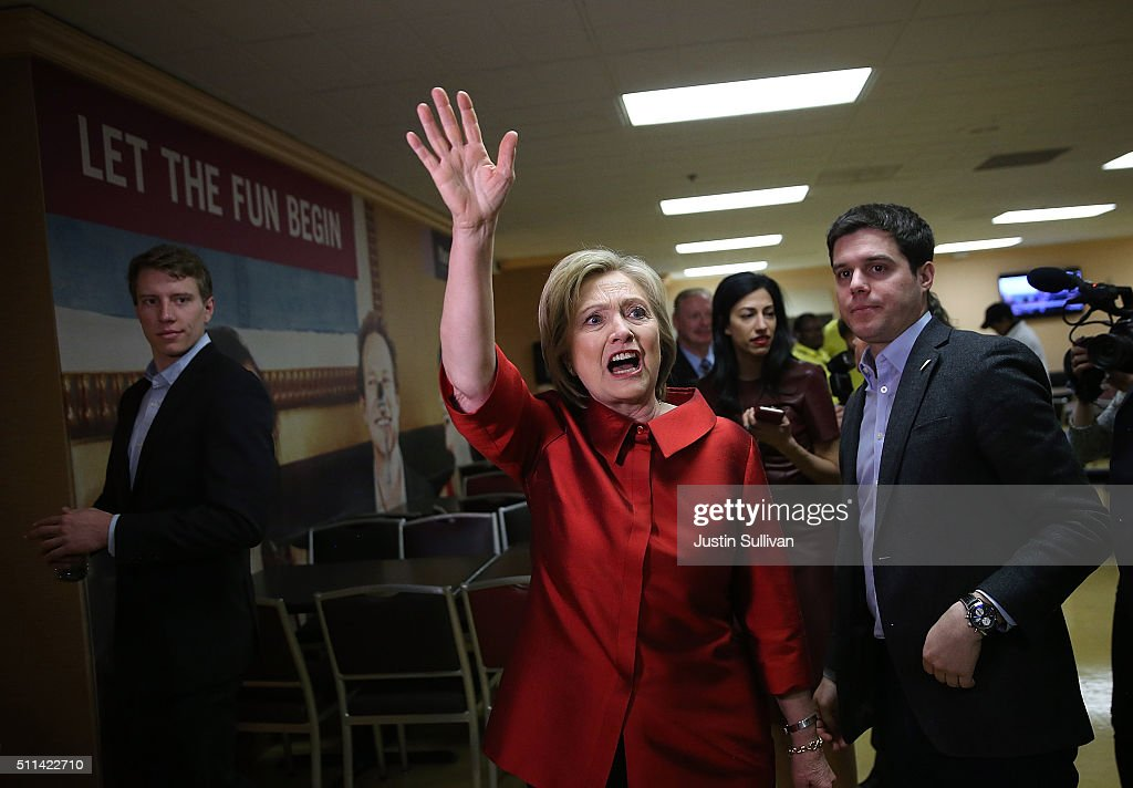 Democratic presidential candidate Hillary Clinton waves to workers inside the employee dining room at Harrah's Las Vegas on February 20, 2016 in Las Vegas, Nevada. Clinton met with casino workers at Harrah's Las Vegas before doors opened for the Nevada Democratic caucus.