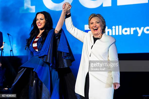 Democratic presidential candidate Hillary Clinton with recording artist Katy Perry during a getoutthevote concert at the Mann Center for the...