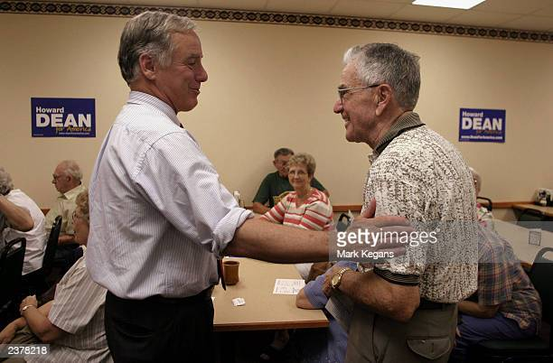 Democratic presidential candidate hopeful Howard Dean greets Bob DeGroote, of Corwith, Iowa, after he spoke at the Pizza Ranch restaurant August 7,...