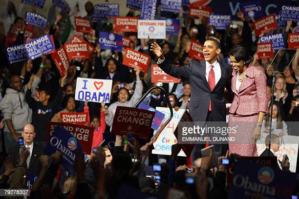 US Democratic presidential candidate Ilinois Senator Barack Obama and his wife Michelle celebrate victory in the South Carolina primary 26 January...