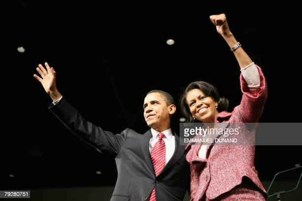 Democratic presidential candidate Ilinois Senator Barack Obama and his wife Michelle celebrate victory in the South Carolina primary 26 January 2008...