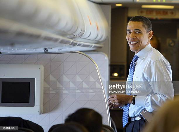 US Democratic presidential candidate Illinois Senator Barack Obama smiles during a charter flight between St Louis Missouri and Wilmington Delaware...