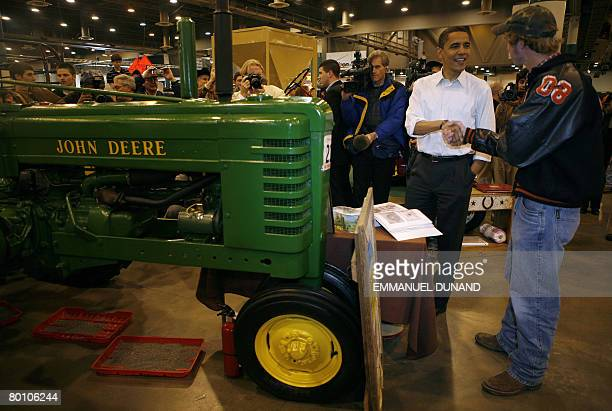Democratic presidential candidate Illinois Senator Barack Obama greets a man while looking at farming equipment during a visit to the Huston...