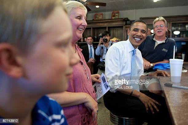 US Democratic presidential candidate Illinois Senator Barack Obama greets customers during a stop at the Ellis Pop Soda Shoppe in Abingdon Virginia...