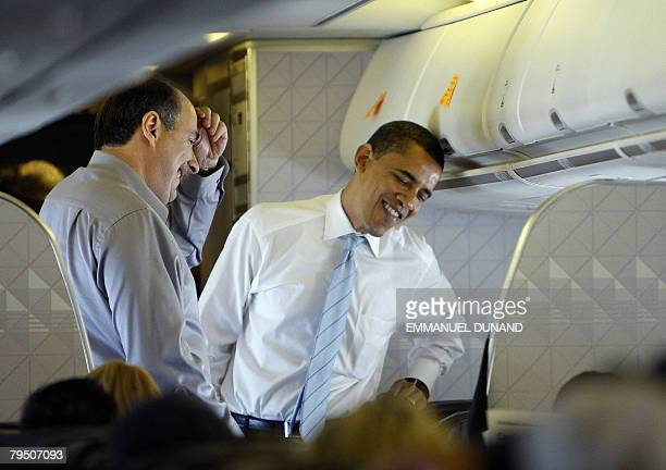 US Democratic presidential candidate Illinois Senator Barack Obama and his senior campaign strategist David Axelrod aboard a plane from Chicago...