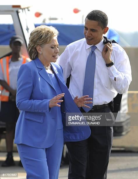 US Democratic presidential candidate Illinois Senator Barack Obama and former candidate Senator Hillary Clinton board a plane at Ronald Reagan...