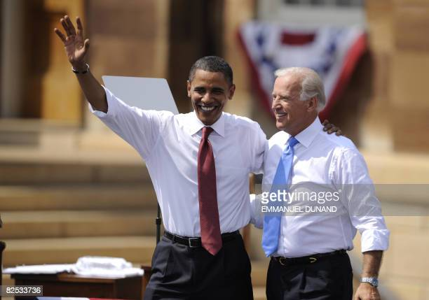 US Democratic presidential candidate Illinois Senator Barack Obama and running mate Delaware Senator Joe Biden wave during a rally in Springfield...