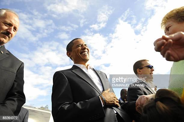 US Democratic presidential candidate Illinois Senator Barack Obama laughs as a young girl mistakes him for John McCain saying hello John McCain at...