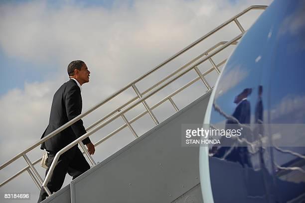 US Democratic presidential candidate Illinois Senator Barack Obama boards his plane October 8 2008 at the airport in Indianapolis Indiana on his way...