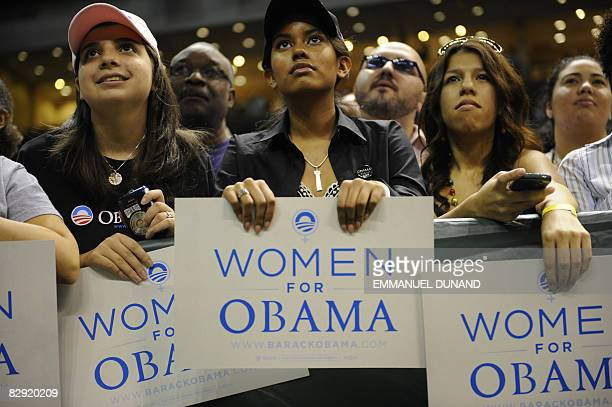 """Democratic presidential candidate Illinois Senator Barack Obama supporters hold signs during a """"Women's Rally For The Change We Need"""" at Bank United..."""
