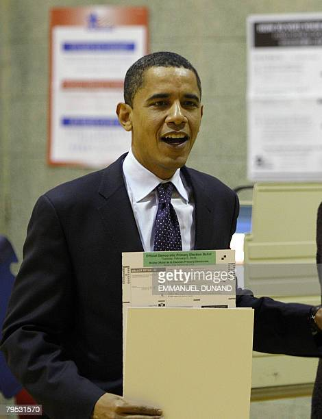 US Democratic presidential candidate Illinois Senator Barack Obama holds his ballot papers while casting his vote in the Super Tuesday primary votes...