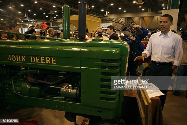 Democratic presidential candidate Illinois Senator Barack Obama looks at farming equipment during a visit to the Huston Livestock Show and Rodeo in...
