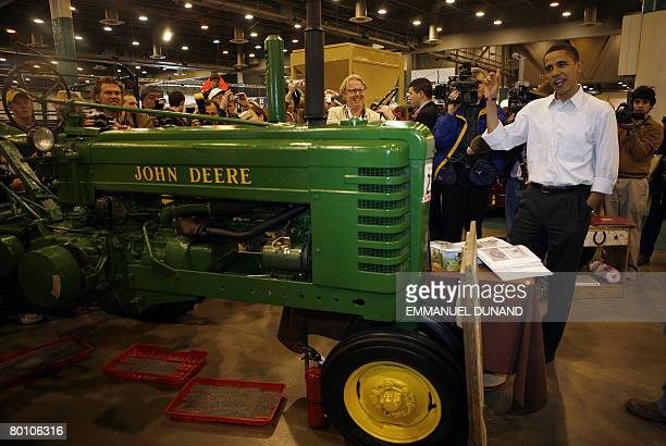 US Democratic presidential candidate Illinois Senator Barack Obama looks at farming equipment during a visit to the Huston Livestock Show and Rodeo...