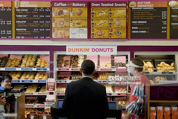 US Democratic presidential candidate Illinois Senator Barack Obama makes an unplanned stop at a local Dunkin' Donuts 08 January 2008 in Manchester...