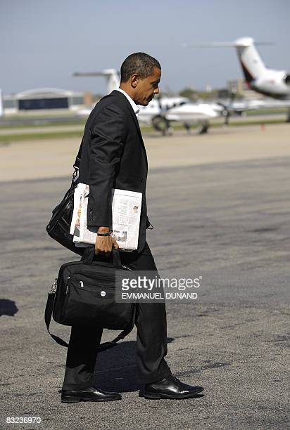 US Democratic presidential candidate Illinois Senator Barack Obama makes his way to his campaign plane at Midway airport in Chicago on October 12...