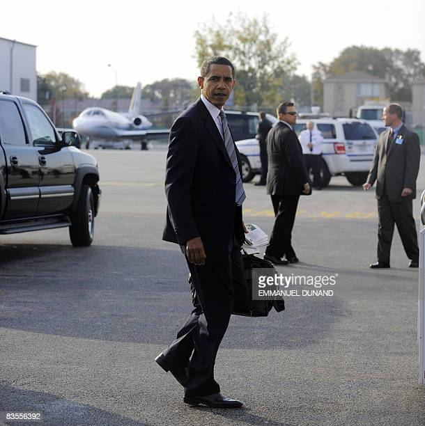 US Democratic presidential candidate Illinois Senator Barack Obama on his way to board his campaign plane on his way to Indianapolis after casting...