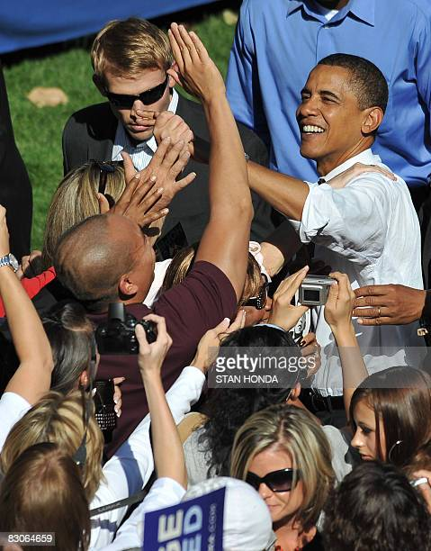 Democratic presidential candidate Illinois Senator Barack Obama greets supporters after rally September 30, 2008 at the University of Nevada at Reno,...