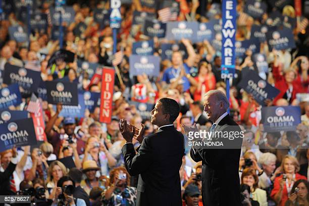 US Democratic presidential candidate Illinois Senator Barack Obama takes to the stage with running mate Delaware Senator Joe Biden during the...