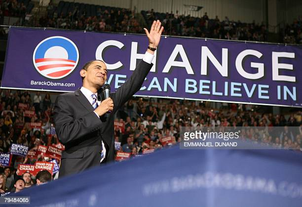 US Democratic presidential candidate Illinois Senator Barack Obama acknowledges the crowd during a rally in Minneapolis Minnesota 02 February 2008...