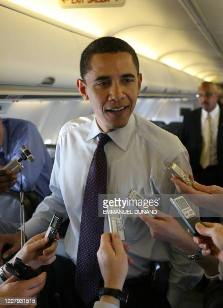 Democratic presidential candidate Illinois Senator Barack Obama speaks to reporters travelling with him aboard a plane bewteem Macon, Georgia, and...