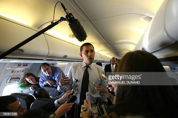 US Democratic presidential candidate Illinois Senator Barack Obama speaks to reporters travelling with him aboard a plane bewteem Macon Georgia and...