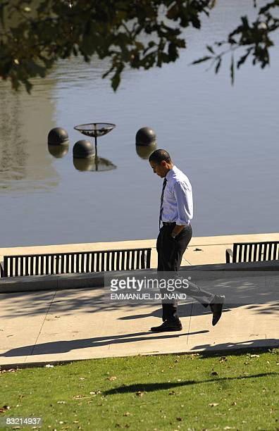 US Democratic presidential candidate Illinois Senator Barack Obama walks on the Scioto river while arriving at a rally at Genoa Park Amphitheatre in...