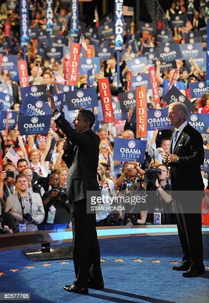 US Democratic presidential candidate Illinois Senator Barack Obama waves to the crowd with running mate Delaware Senator Joe Biden at the Democratic...