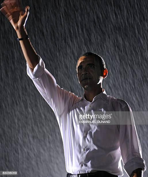 Democratic presidential candidate Illinois Senator Barack Obama waves as rain falls during a rally with running mate Joe Biden at the University of...