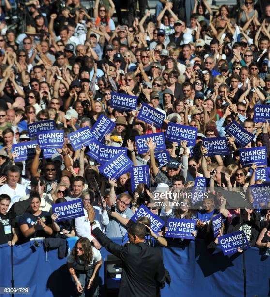 Democratic presidential candidate Illinois Senator Barack Obama waves to crowd at rally September 30, 2008 at the University of Nevada at Reno,...