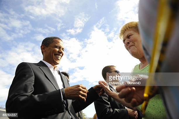 US Democratic presidential candidate Illinois Senator Barack Obama laughs with a supporter after her granddaughter mistook him for John McCain saying...
