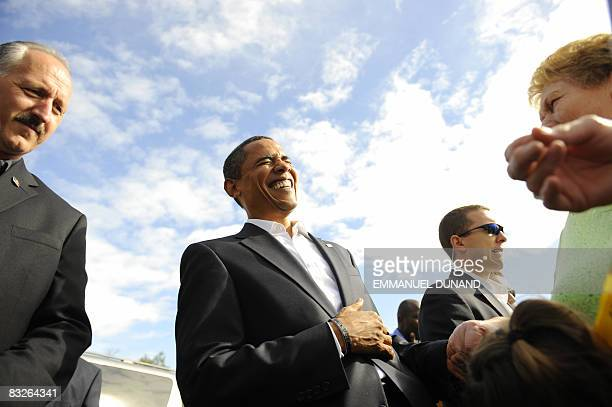 US Democratic presidential candidate Illinois Senator Barack Obama laughs with a supporter after her grand aughter mistook him for John McCain saying...