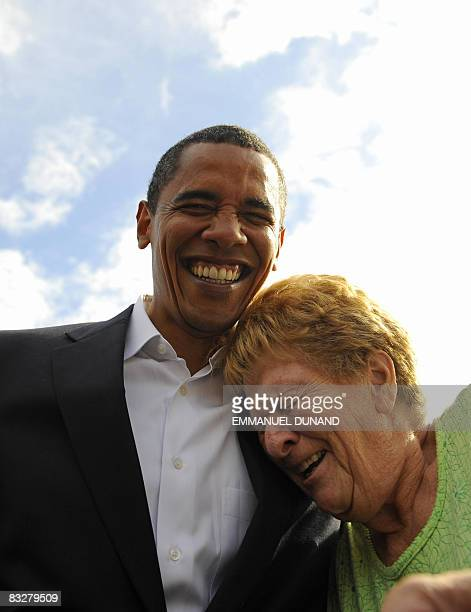 US Democratic presidential candidate Illinois Senator Barack Obama laughts with a supporter after her granddaughter mistook him for John McCain...