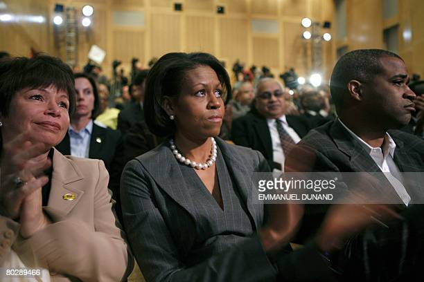 Democratic presidential candidate Illinois Senator Barack Obama's wife Michelle applauds as her husband speaks at the National Constitution Center in...