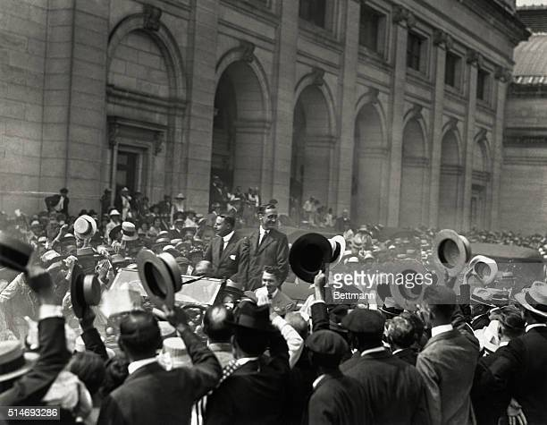 Democratic Presidential candidate James Cox and his running mate Franklin Roosevelt pass through a crowd of cheering onlookers during their campaign.